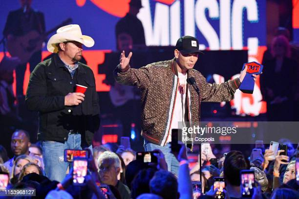 Toby Keith presents an award to Kane Brown at the 2019 CMT Music Awards at Bridgestone Arena on June 05 2019 in Nashville Tennessee