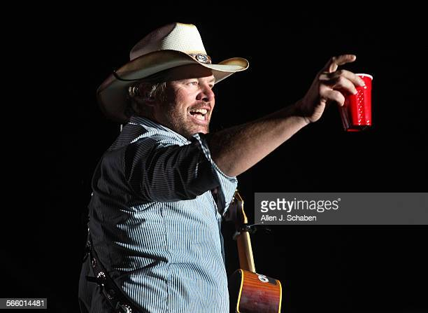 Toby Keith toasts his fans with a red solo cup, the name of one of his hit songs on the Mane Stage during the first day of the Stagecoach Country...