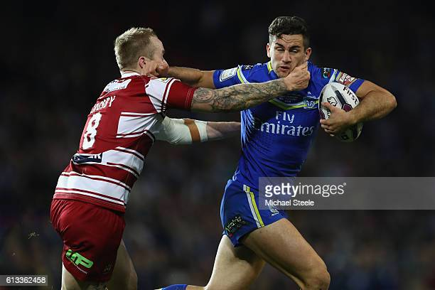 Toby King of Warrington challenged by Dominic Crosby of Wigan during the First Utility Super League Final between Warrington Wolves and Wigan...