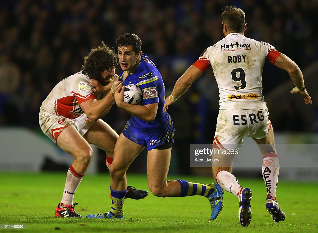 Toby King of Warrington Wolves is tackled by Kyle Amor of St Helens during the First Utility Super League Semi Final match between Warrington Wolves and St Helens at The Halliwell Jones Stadium on September 29, 2016 in Warrington, England.