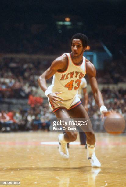 Toby Knight of the New York Knicks dribbles the ball against the Chicago Bulls during an NBA basketball game circa 1978 at Madison Square Garden in...