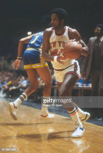 Toby Knight of the New York Knicks drives towards the basket against the Indiana Pacers during an NBA basketball game circa 1978 at Madison Square...