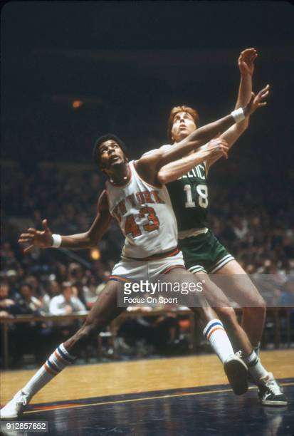 Toby Knight of the New York Knicks fights for position with Dave Cowens of the Boston Celtics during an NBA basketball game circa 1978 at Madison...