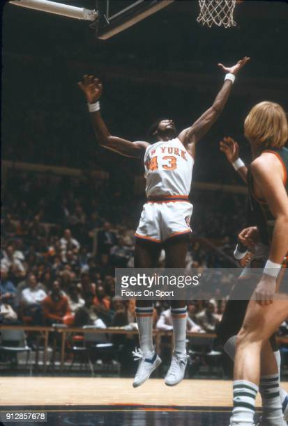 Toby Knight of the New York Knicks goes up for a rebound against the Milwaukee Bucks during an NBA basketball game circa 1978 at Madison Square...