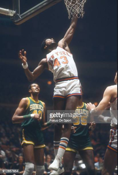 Toby Knight of the New York Knicks goes up to grab a rebound against the Seattle Supersonics during an NBA basketball game circa 1978 at Madison...