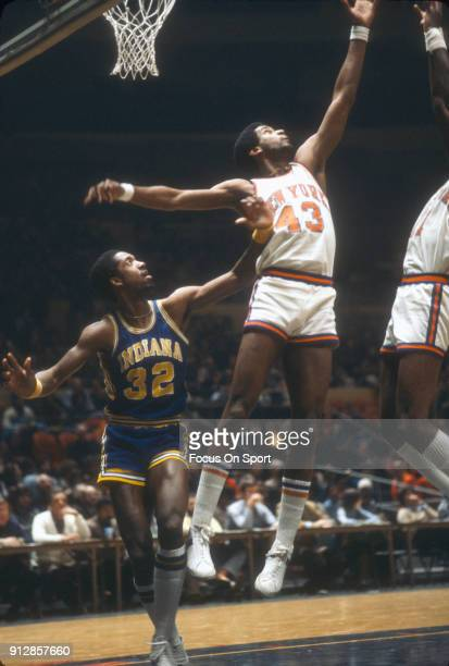 Toby Knight of the New York Knicks leaps for a rebound against the Indiana Pacers during an NBA basketball game circa 1978 at Madison Square Garden...