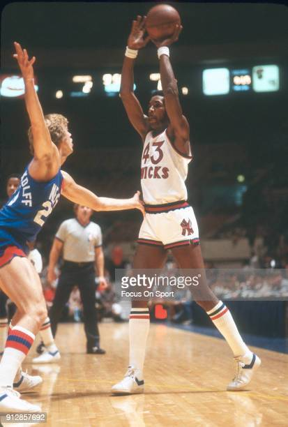 Toby Knight of the New York Knicks looks to pass the ball over the top of Jan Van Breda Kolff of the New Jersey Nets during an NBA basketball game...