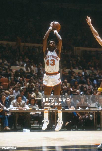 Toby Knight of the New York Knicks shoots against the New Orleans Jazz during an NBA basketball game circa 1978 at Madison Square Garden in the...