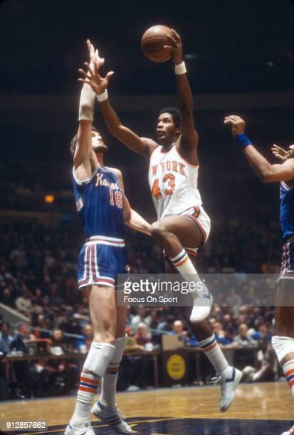 Toby Knight of the New York Knicks shoots over Tom Burleson of the Kansas City Kings during an NBA basketball game circa 1978 at Madison Square...