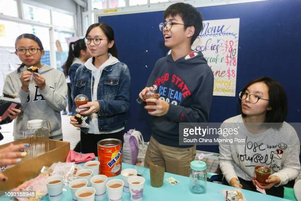 Toby Lau Hangshan 15 Alice Law Ngating 15 Derry Lau Cheukwang 15 and Liel Chengto sell snacks and drinks during a minicarnival event at Shung Tak...