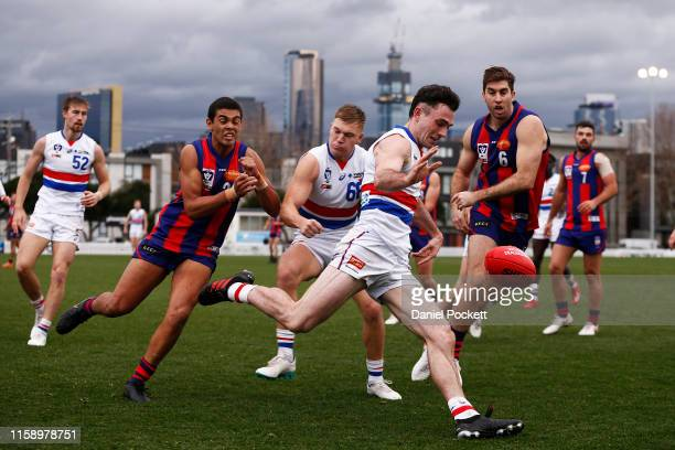 Toby McLean of the Bulldogs kicks the ball during the round 13 VFL match between Port Melbourne and Footscray at Adcon Stadium on June 29, 2019 in...