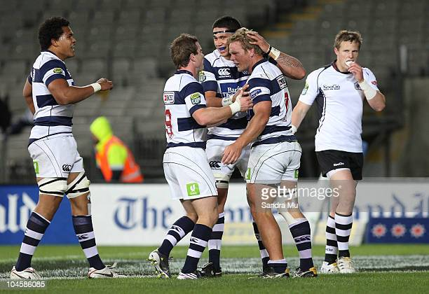 Toby Morland and Kurtis Haiu of Auckland congratulate Daniel Braid of Auckland after he scored a try during the round 10 ITM Cup match between...