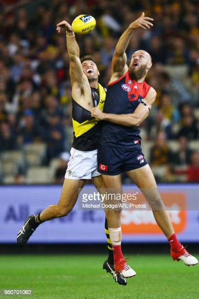 Toby Nankervis of the Tigers and Max Gawn of the Demons compete for the ball during the 2018 AFL round five match between the Melbourne Demons and...