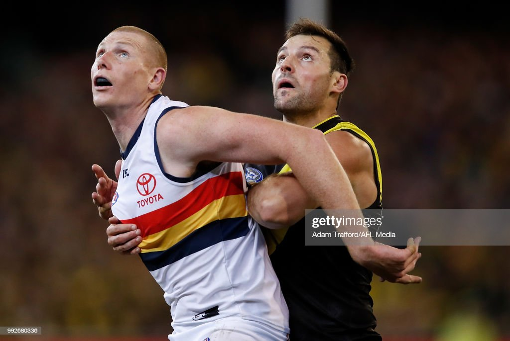 Toby Nankervis of the Tigers and Sam Jacobs of the Crows compete in a ruck contest during the 2018 AFL round 16 match between the Richmond Tigers and the Adelaide Crows at the Melbourne Cricket Ground on July 06, 2018 in Melbourne, Australia.