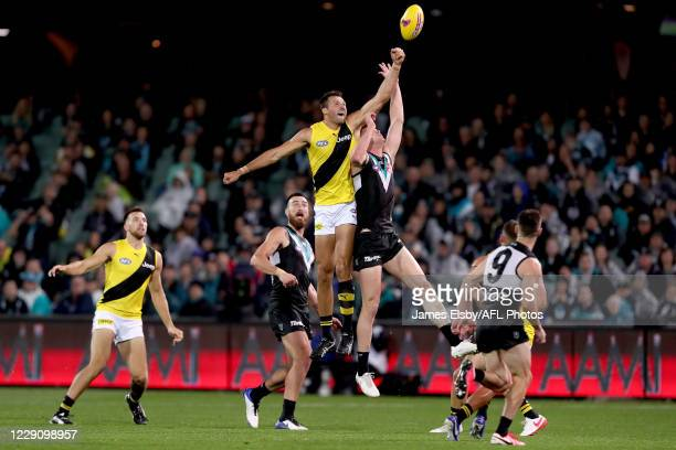 Toby Nankervis of the Tigers competes with Peter Ladhams of the Power during the 2020 AFL First Preliminary Final match between the Port Adelaide...