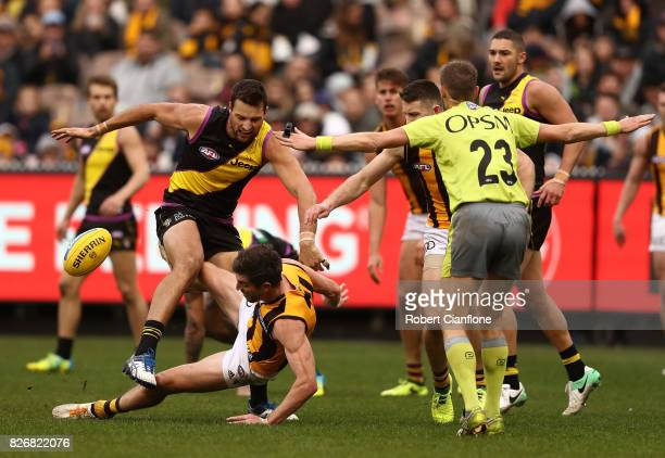Toby Nankervis of the Tigers knocks over Ricky Henderson of the Hawks during the round 20 AFL match between the Richmond Tigers and the Hawthorn...