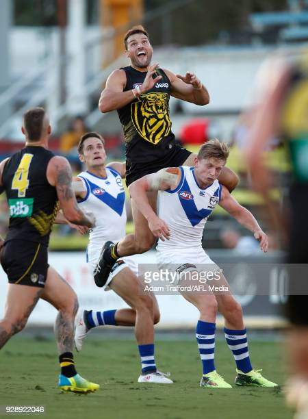 Toby Nankervis of the Tigers marks the ball over Jack Ziebell of the Kangaroos during the AFL 2018 JLT Community Series match between the Richmond...