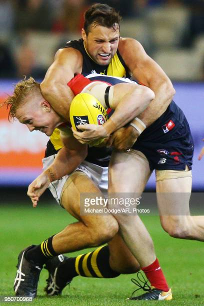 Toby Nankervis of the Tigers tackles Clayton Oliver of the Demons during the 2018 AFL round five match between the Melbourne Demons and the Richmond...