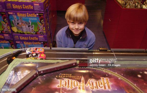 Toby Parfitt from Woodbridge in Suffolk looks at Hornby's new Harry Potter Hogwart's Express train at Hamleys toyshop in London prior to the release...