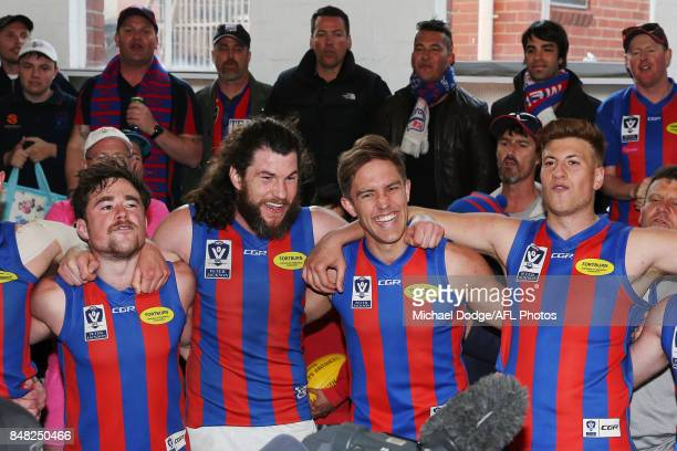 Toby Pinwill and Chris Cain of Port Melbourne celebrate the winwith teamates during the VFL Preliminary Final match between Williamstown and Port...