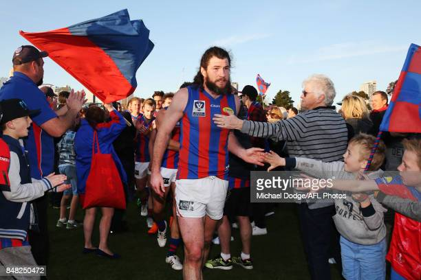 Toby Pinwill of Port Melbourne celebrates the win with fans during the VFL Preliminary Final match between Williamstown and Port Melbourne at...