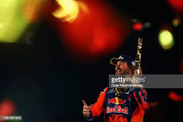Toby Price of Australia from the KTM Factory Racing Team No 3 Motorbike celebrates victory and his 1st palce on the podium after Stage Ten and the...