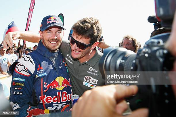 Toby Price of Australia riding on and for KTM 450 RED BULL KTM FACTORY TEAM celebrates winning and is embraced by former Dakar Champion and current...