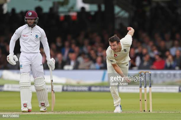 Toby RolandJones of England bowls as Shai Hope of West Indies looks on during day one of the 1st Investec Test match between England and West Indies...