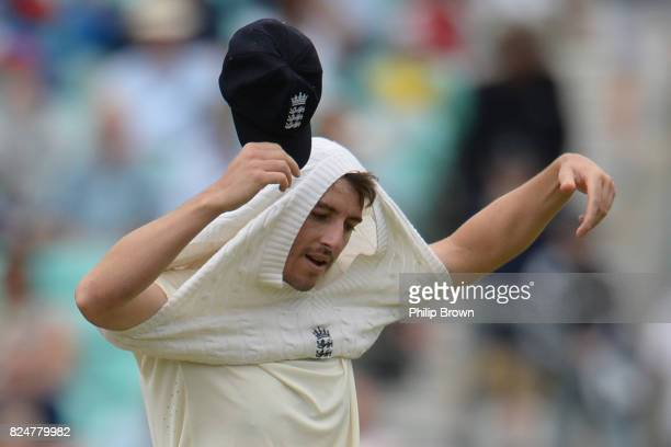 Toby RolandJones of England puts a jumper on during the fifth day of the 3rd Investec Test match between England and South Africa at the Kia Oval on...