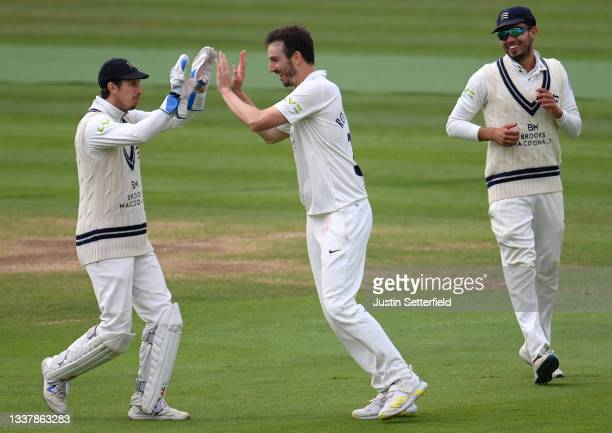 Toby Roland-Jones of Middlesex celebrates with John Simpson of Middlesex after taking the wicket of Alex Hughes of Derbyshire during Day four of the...