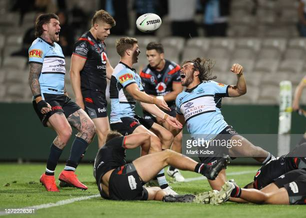 Toby Rudolf of the Sharks celebrates after scoring a try during the round 18 NRL match between the Cronulla Sharks and the New Zealand Warriors at...
