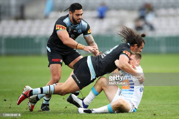 Toby Rudolf of the Sharks tackles Alex Brimson of the Titans during the round 14 NRL match between the Cronulla Sharks and the Gold Coast Titans at...