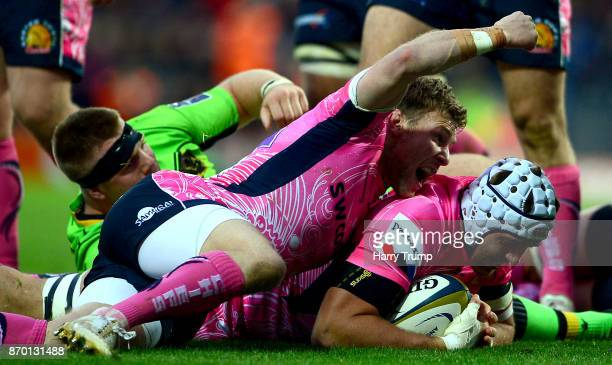 Toby Salmon of Exeter Chiefs goes over for a try as Will Chudley of Exeter Chiefs celebrates during the AngloWelsh Cup match between Exeter Chiefs...