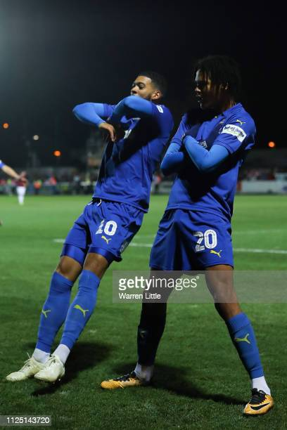 Toby Sibbick of AFC Wimbledon celebrates with his team mate Jake Jervis after scoring his team's fourth goal during the FA Cup Fourth Round match...