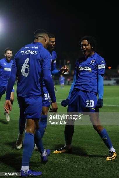 Toby Sibbick of AFC Wimbledon celebrates with his team mates after scoring his team's fourth goal during the FA Cup Fourth Round match between AFC...