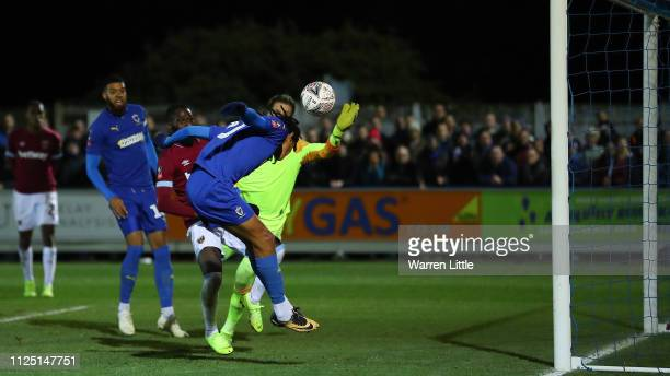 Toby Sibbick of AFC Wimbledon scores his team's fourth goal during the FA Cup Fourth Round match between AFC Wimbledon and West Ham United at The...