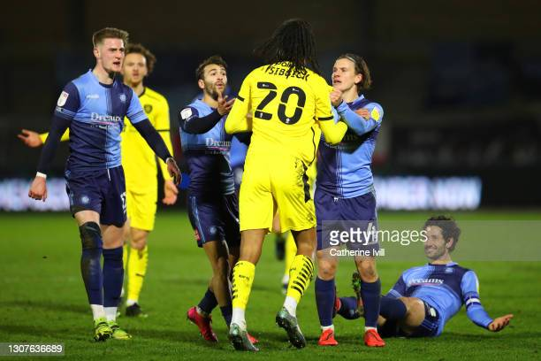 Toby Sibbick of Barnsley FC tassles with Dominic Gape of Wycombe Wanderers during the Sky Bet Championship match between Wycombe Wanderers and...