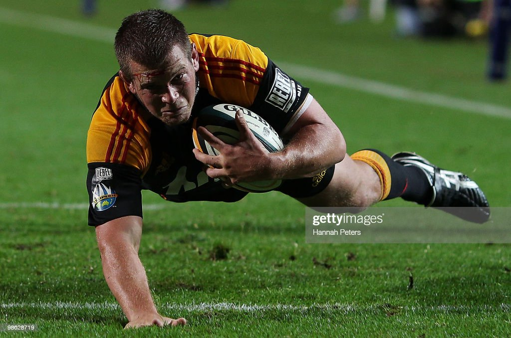 Toby Smith of the Chiefs dives over to score during the round 11 Super 14 match between the Chiefs and the Cheetahs at Waikato Stadium on April 23, 2010 in Hamilton, New Zealand.