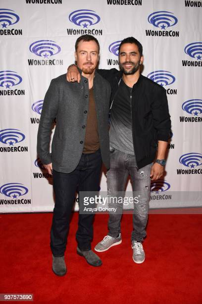 Toby Stephens and Ignacio Serricchio attend the 'Lost in Space' press conference at WonderCon 2018 Day 2 at Anaheim Convention Center on March 24...
