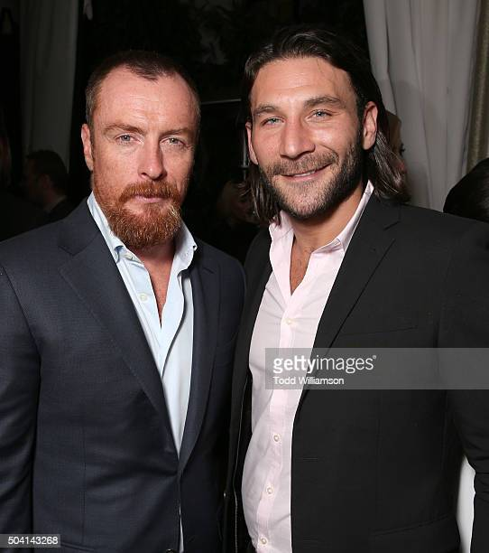 Toby Stephens and Zach McGowan attend the Starz PreGolden Globe Celebration at Chateau Marmont on January 8 2016 in Los Angeles California