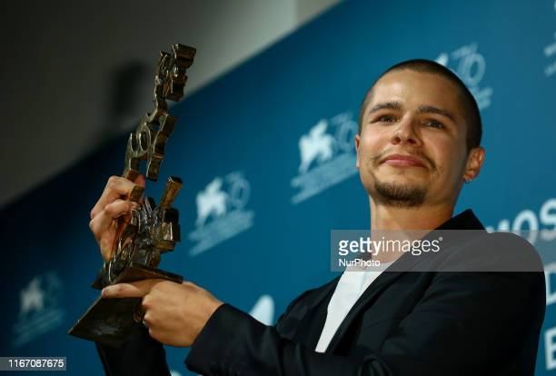 Toby Wallace poses with the Marcello Mastroianni Award for Best Young Actor for quotBabyteethquot at the Winners Photocall during the 76th Venice...