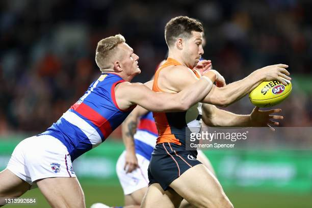 TobyGreene of the Giants is tackled by Adam Treloar of the Bulldogs during the round six AFL match between the Greater Western Sydney Giants and the...