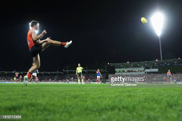 TobyGreene of the Giants kicks during the round 3 AFL match between the GWS Giants and the Melbourne Demons at Manuka Oval on April 04, 2021 in...
