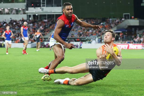 TobyGreene of the Giants marks during the round 3 AFL match between the GWS Giants and the Melbourne Demons at Manuka Oval on April 04, 2021 in...