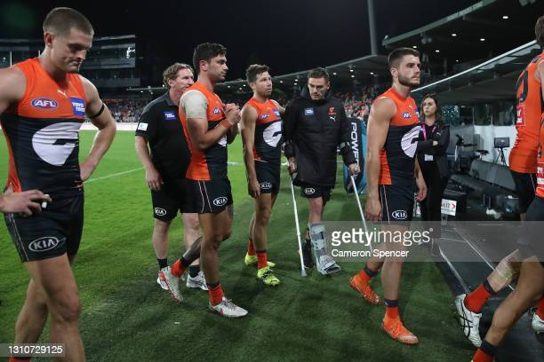 TobyGreene of the Giants talks to injured captain StephenConiglio of the Giants after losing the round 3 AFL match between the GWS Giants and the...