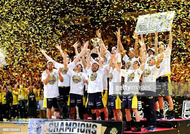 Tochigi Brex players celebrate winning the B League Championship final match between Kawasaki Brave Thunders and Tochigi Brex at Yoyogi National...