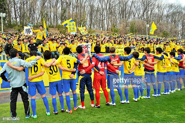 Tochigi SC players celebrate their 20 win with their supporters after the JLeague third division match between Tochigi SC and Fujieda MYFC at the...