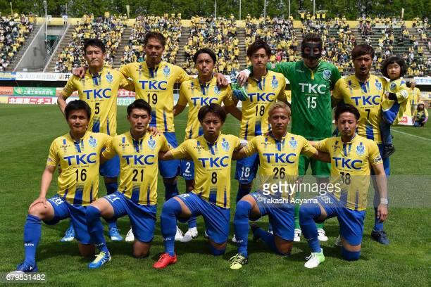Tochigi SC players line up for the team photos prior to the JLeague J3 match between Tochigi SC and Giravanz Kitakyushu at Tochigi Green Stadium on...