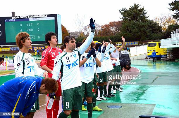 Tochigi SC players wave to supporters after the JLeague second division match between Thespa Kusatsu and Tochigi SC at Shoda Shoyu Stadium Gunma on...