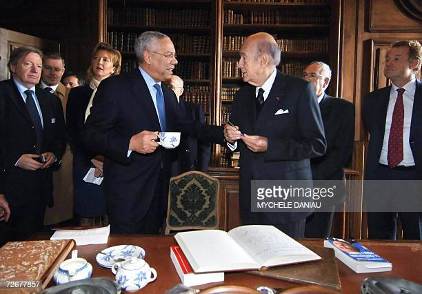 Former US Secretary of State Colin Powell talks with former French President Valery Giscard d'Estaing after being awarded the Alexis de Tocqueville...